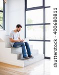 happy man sitting on steps... | Shutterstock . vector #400680811