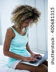 young woman using a laptop on... | Shutterstock . vector #400681315