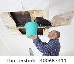 man collecting water in bucket ...   Shutterstock . vector #400687411