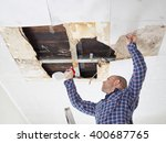 Man Cleaning Mold On Ceiling...