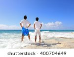 men on a tropical beach  | Shutterstock . vector #400704649