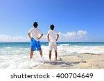 men on a tropical beach  | Shutterstock . vector #400704649