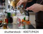 bartender coocks cocktail...   Shutterstock . vector #400719424