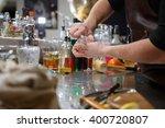 bartender pours alcoholic drink ... | Shutterstock . vector #400720807