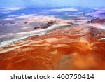 aerial view of high red dunes ... | Shutterstock . vector #400750414