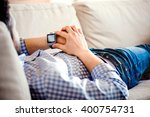 man lying on sofa at home using ... | Shutterstock . vector #400754731
