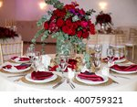 table setting at a luxury... | Shutterstock . vector #400759321