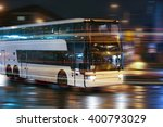 tourist bus moves in the night... | Shutterstock . vector #400793029