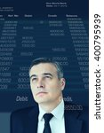 Small photo of Looking into future. Digitally generated image of mature businessman looking up at account statement