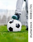 feet of little boy on ball on... | Shutterstock . vector #400811701