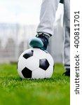 feet of little boy on ball on... | Shutterstock . vector #400811701