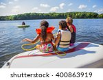 family tubing from a boat on an ... | Shutterstock . vector #400863919
