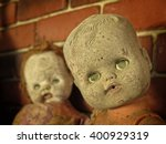 Two Creepy Dolls In An...