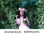 Small photo of fairy portrait of beautiful asian teen girl with flower wreath