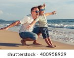 father and son playing on the... | Shutterstock . vector #400958929