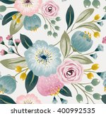 Stock vector vector illustration of a seamless floral pattern with spring flowers lovely floral background in 400992535