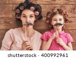 funny family  mother and her... | Shutterstock . vector #400992961