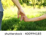a the parent holds the hand of... | Shutterstock . vector #400994185