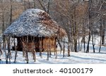 Old house and snow in the forest - stock photo