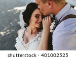 bride and groom sit on the... | Shutterstock . vector #401002525