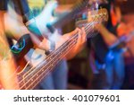 aggressive play guitar on stage | Shutterstock . vector #401079601