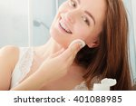 woman removing makeup with... | Shutterstock . vector #401088985