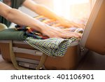 young hipster packing his...   Shutterstock . vector #401106901