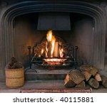 A Roaring Fire Within A Large...