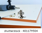 Stock photo hinge assembly on kitchen cabinet door 401179504