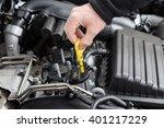 check the oil  in modern car... | Shutterstock . vector #401217229