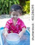 cute asian girl smiling when... | Shutterstock . vector #401286295