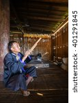 Small photo of MAE HONG SON, THAILAND - DECEMBER 3 : portrait of an old Lahu tribe man playing Lusheng, a traditional Chinese wind instrument. on December 3, 2015.