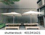 two white patio umbrellas... | Shutterstock . vector #401341621