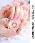 hands of a woman with pink...   Shutterstock . vector #401362744