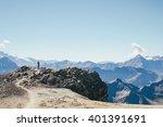 man hiking on top of mount... | Shutterstock . vector #401391691