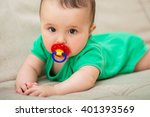 cute baby with a pacifier | Shutterstock . vector #401393569