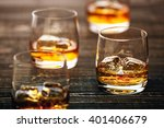whiskey with ice on a black... | Shutterstock . vector #401406679