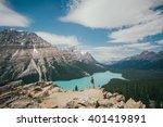 the girl is watching peyto lake ... | Shutterstock . vector #401419891