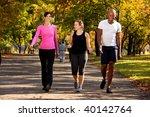 three people walking in a park  ... | Shutterstock . vector #40142764
