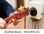detail of a technician using a... | Shutterstock . vector #401454121