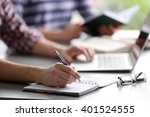 student's hand writing in... | Shutterstock . vector #401524555