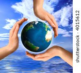 Conceptual recycling symbol made from hands and a small Earth globe Environment and ecology concept - stock photo