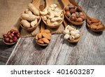 healthy mix nuts on wooden... | Shutterstock . vector #401603287