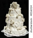 White iced wedding cake isolated on black background - stock photo