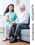 caring young caregiver in... | Shutterstock . vector #401669479