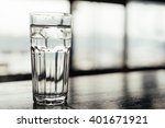 glass of ice water on the table | Shutterstock . vector #401671921