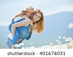 woman and child in nature | Shutterstock . vector #401676031