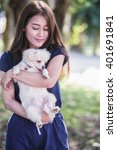 asia happy young woman with dog | Shutterstock . vector #401691841