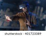 guy using vr glasses | Shutterstock . vector #401723389