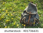 retro backpack on a meadow | Shutterstock . vector #401736631